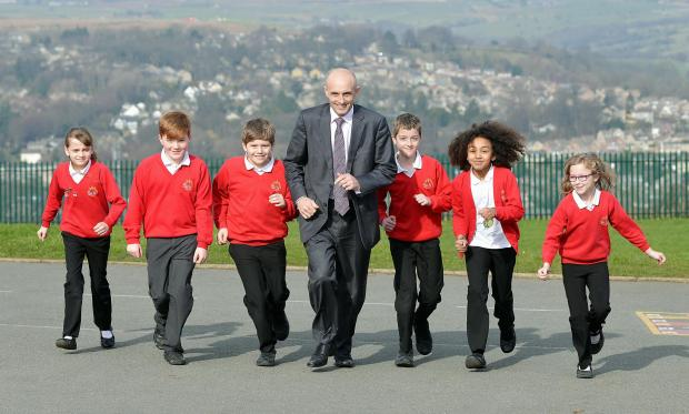 Bradford Telegraph and Argus: Idle C of E Primary School head teacher John Bowers with pupils
