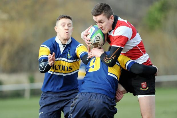 Bradford Telegraph and Argus: Cleckheaton full back Ross Hayden is tackled by Old Crossleyans scrum half Will Brian