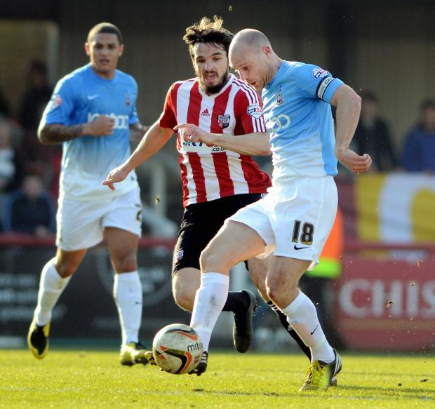 Phil Parkinson's plans have been hit by the loss of Gary Jones (pictured playing against Brentford at the weekend) and James Hanson