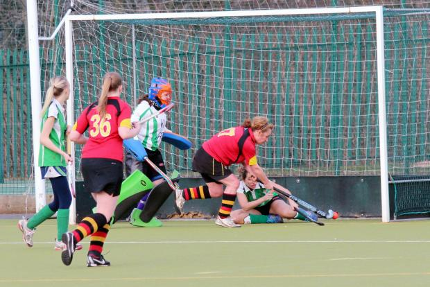 Jane Sharkey scores for Bingley Bees Ladies Seconds, watched by player of the match Sarah Eaton – Picture: Michael Wood