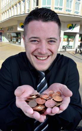 Yorkshire Building Society employee Jack Muff with part of customers' donations