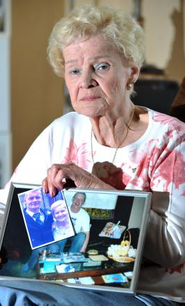 Margaret McKendrick with pictures of her son, Dave Black