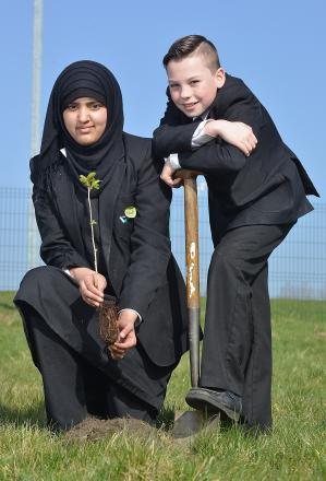 Hanson School pupils Ikra Iqbal and Samuel Davis planting trees