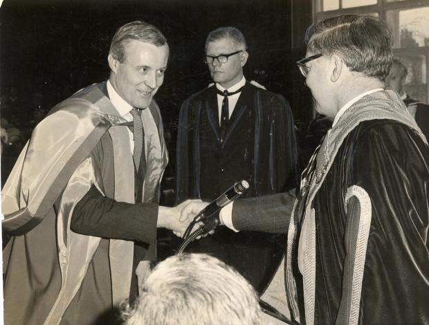Tony Benn receives the honorary degree of Doctor of Technology from the Vice-Chancellor of Bradford University, Dr. E. G. Edwards, at a degree ceremony at the University. April 1969