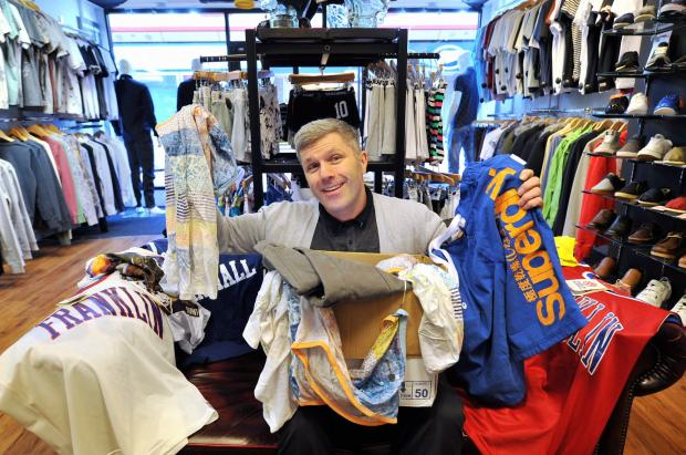 Mark Dale, of Pink V Blue, donates surplus stock to the British Heart Foundation store in Keighley's Airedale Shopping Centre, where his shop is located