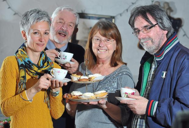 Volunteers Helen Potts, Philip Kirtley, Sue Higgins and Mike O'Leary enjoy their tea and cakes
