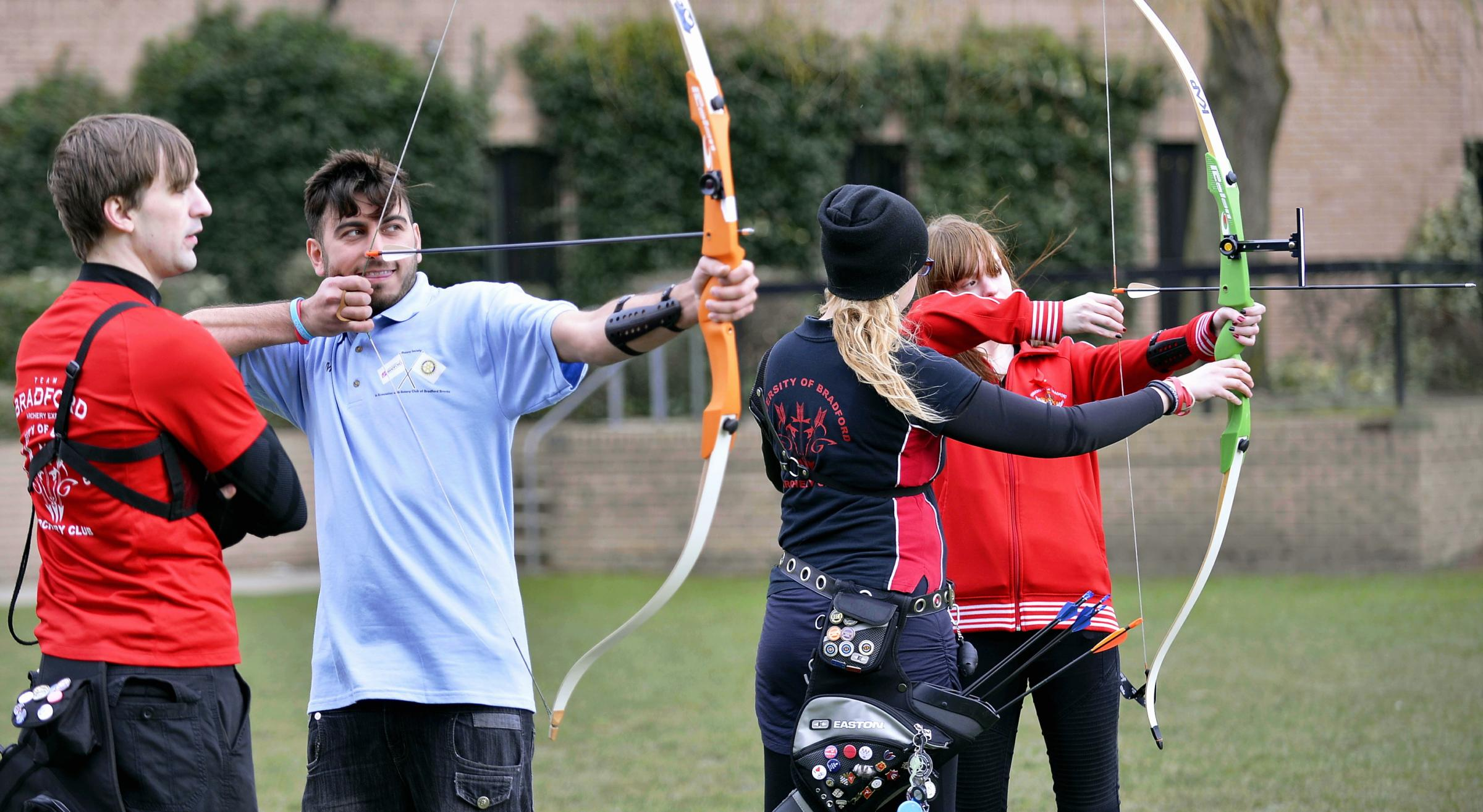 From left, University of Bradford students Dean Dowling, Imran Khan, Shelly Hurst and Gemma Jackson take part in an archery contest during the Colours Carnival