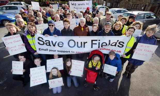 Protesters in Thackley against plans to develop fields on land close to the village march round the area