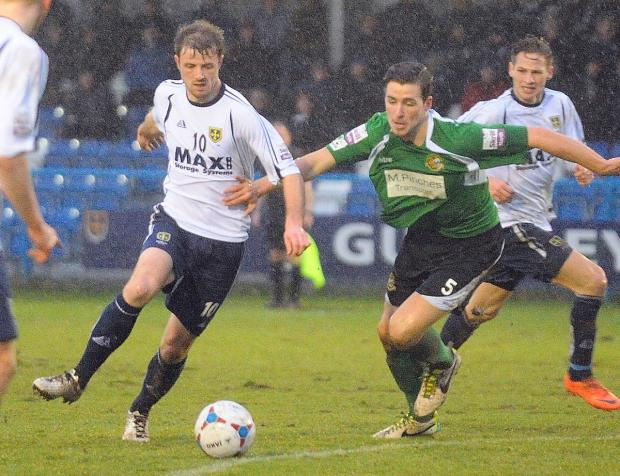 Adam Boyes, left, scored with a clinical chip to put Guiseley 2-1 ahead