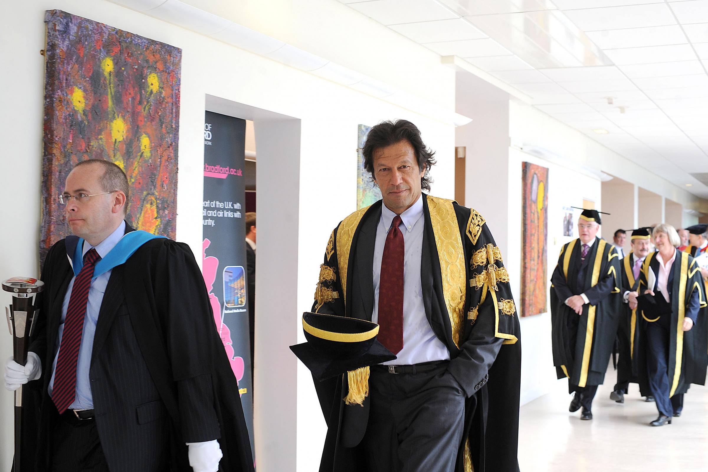 Imran Khan, pictured at a graduation ceremony, is to have his role as Chancellor of the University of Bradford questioned