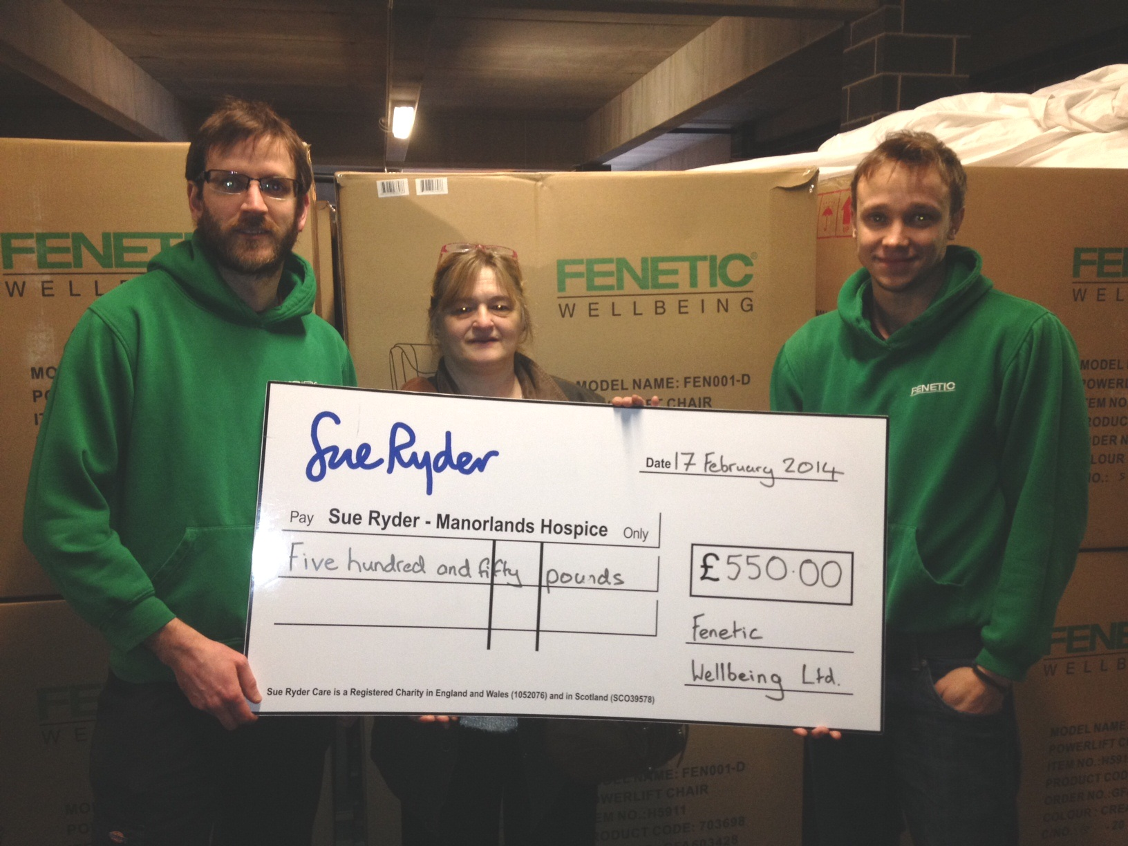 Margaret Patel, from Manorlands, receives a cheque from Graeme Firth (left) and Tom Appelbee of Fenetic Wellbeing