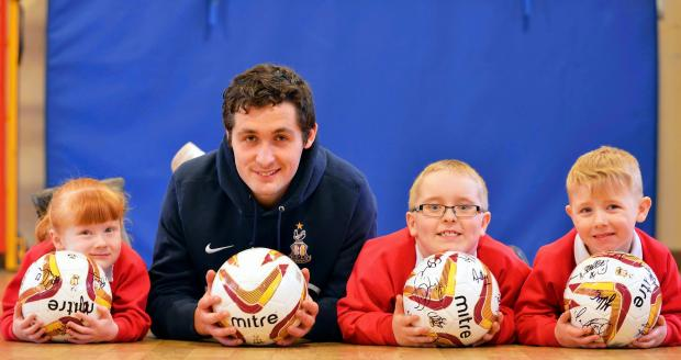 City star Carl McHugh thanks young fundraisers at Wrose School