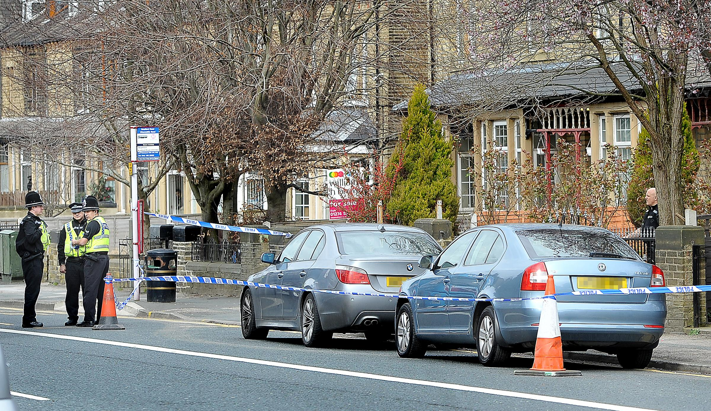 Police attend an incident and close off part of the pavement on Bradford Road opposite Redburn Road