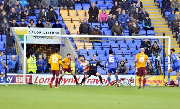 Shaun Miller acrobatically fires home Shrewsbury's last-kick winning goal as City lost 2-1 after taking the lead