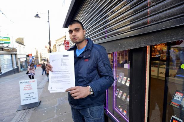 CONCERNS: Muhammad Rizwan with his letter from Bradford Council