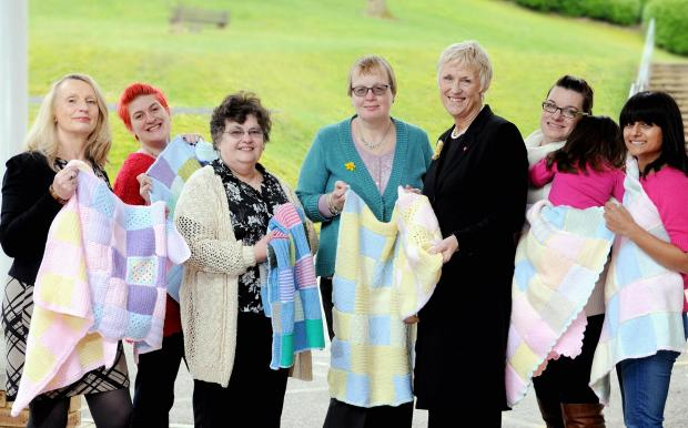 Tricia Stewart (centre in black) is pictured with members of Bingley Women's Institute
