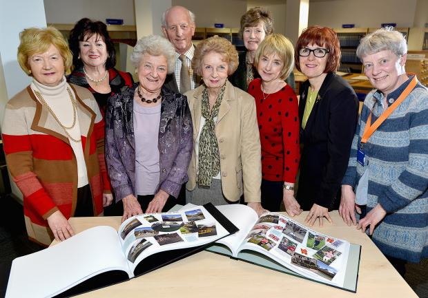 At the handover to the library are (from left) Gaye Baird, Baroness Eaton, Jean Baudouin, Stuart Cummins (who bound the book), Dorothy Simmonite, Vicky Furness, Susan Caswell and Beverley Caton from the Library