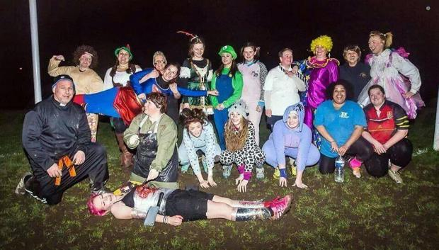 The women and girls dress up for their fundraising training session in aid of the Sport Relief cause
