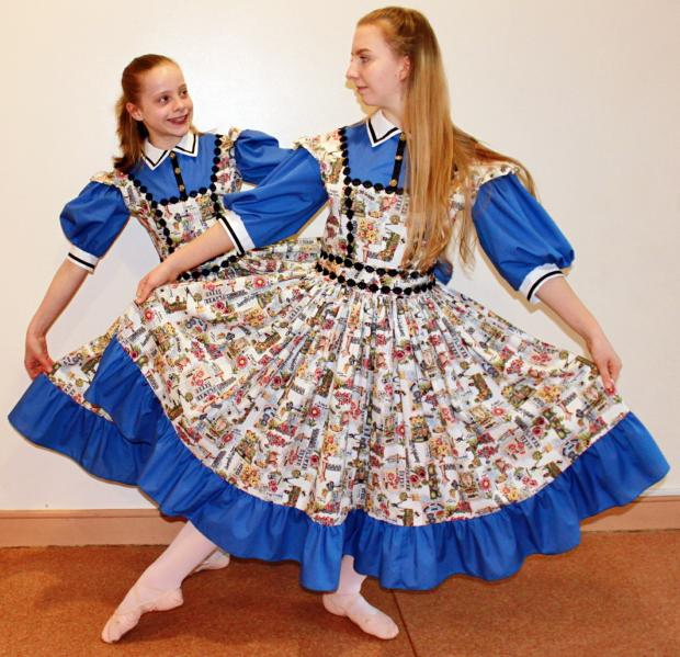 Bea Debney, 16, as Alice, and Emily Ackroyd, 11, as Little Alice in the show