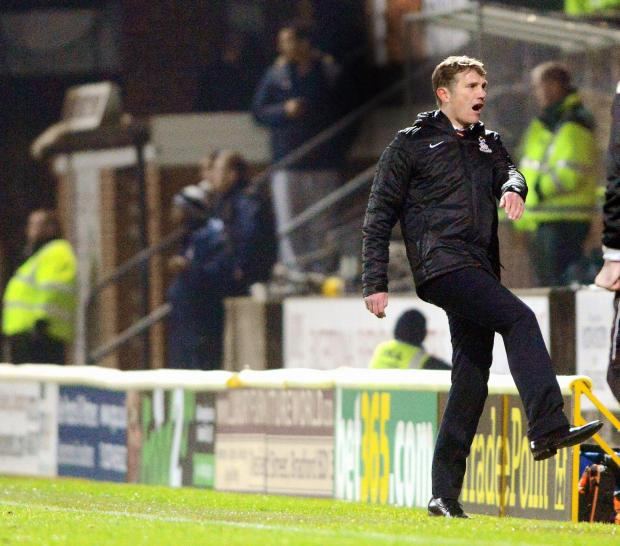 City boss Phil Parkinson shows his frustration after Walsall's second goal