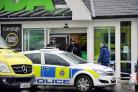 Police at Asda, Shipley, where Sobia Yousef stabbed herself to death