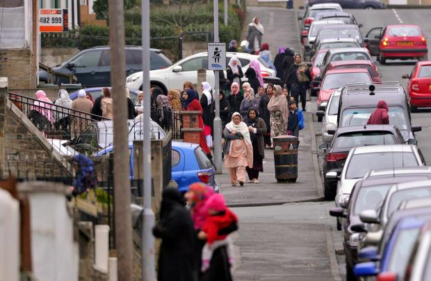 Bradford Telegraph and Argus: Women at the Jami'at Tabligh Mosque on Aireville Road, Frizinghall, for the funeral of Sobia Yousef