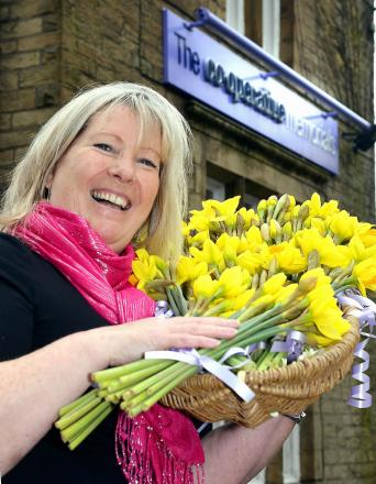 Gill Harney with some of the daffodils she has presented to Bingley churches
