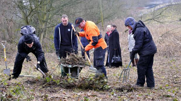 Luke Fowler, pictured with Incommunities workers helping The Hirst Wood Regen Group