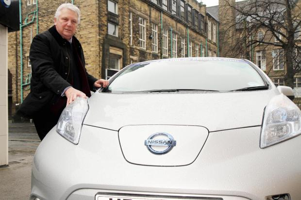 Bradford Telegraph and Argus: Company owner Stuart Hastings with the electric car