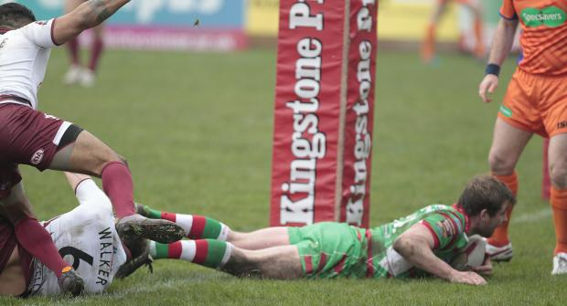 Bradford Telegraph and Argus: Josh Lynam touches down for a try. Pictures: Charlie Perry