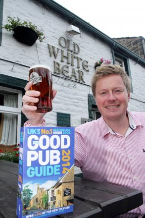 Neil Pickles, of the Old White Bear in Cross Hills, celebrating its inclusion in the Good Pub Guide