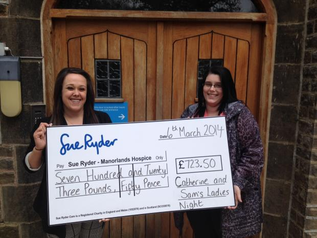 Sam Turner and Catherine Whiteoak with their cheque for Manorlands, part of the proceeds of the charity ladies' night