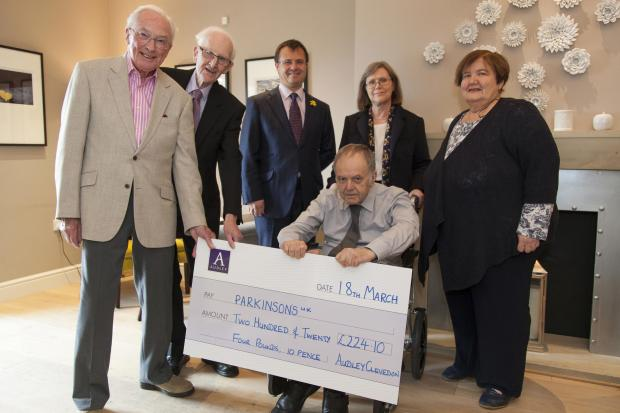 From left are event organiser and Audley Cleved resident Me Lee, chairman of Parkinson's UK Skipton cranch Allan Cawood, general manager of Audley Clevedon David Kanarens, residents Peter and Cilla Seago and treasurer at Parkinson's UK Skipton branch Gill