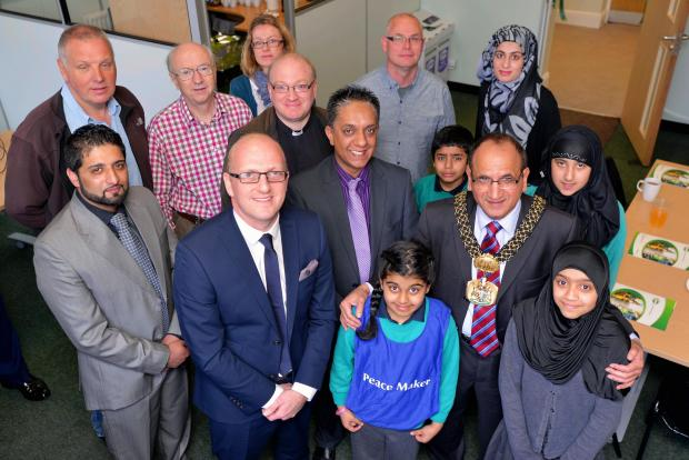 The Lord Mayor of Bradford Coun Khadim Hussain with marketing manager Mike Robinson, councillors and members from Friends Of Frizinghall