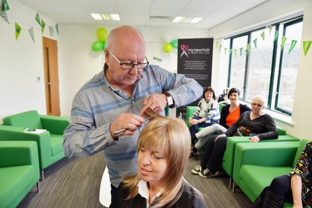 Trevor Sorbie cuts a wig at the Macmillan Cancer Support centre in Saltaire