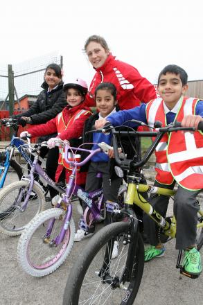 Joining in the cycling session with Emily Groves, of Sustrans, are Riddlesden St Mary's Primary School pupils (from left) Sanya Adrees, Sophie Newton, Mahdiya Khan and Ibrahim Nazir