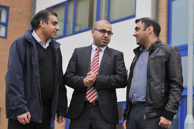 FEARS: Amjad Ahmed, Najeeb Khan and Nazam Azam meet at Grange Interlink Community Centre to discuss the problem of many late-night businesses in the Great Horton Road area