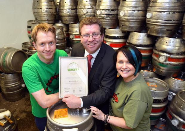 MP Gerry Sutcliffe receives his award from Salamander Brewery in Dudley Hill. He is pictured with owner Damien Gent and sales direcrtor Cassie Sykes