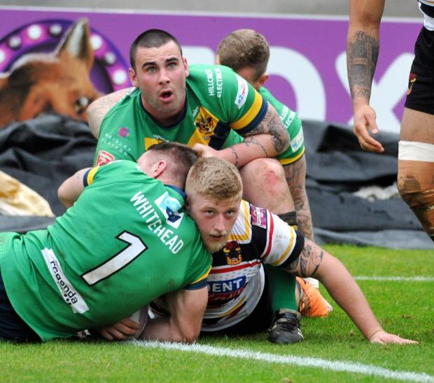 Bradford Telegraph and Argus: Danny Addy touches down for one of the 11 Bulls tries they scored against Oldham