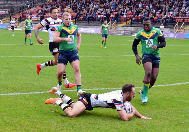 Luke Gale dives over for one of his hat-trick of tries for the Bulls against Oldham