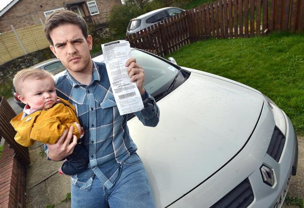 Dad Garry Gledhill with the parking ticket he was given after rushing to hospital to see his poorly son Albert