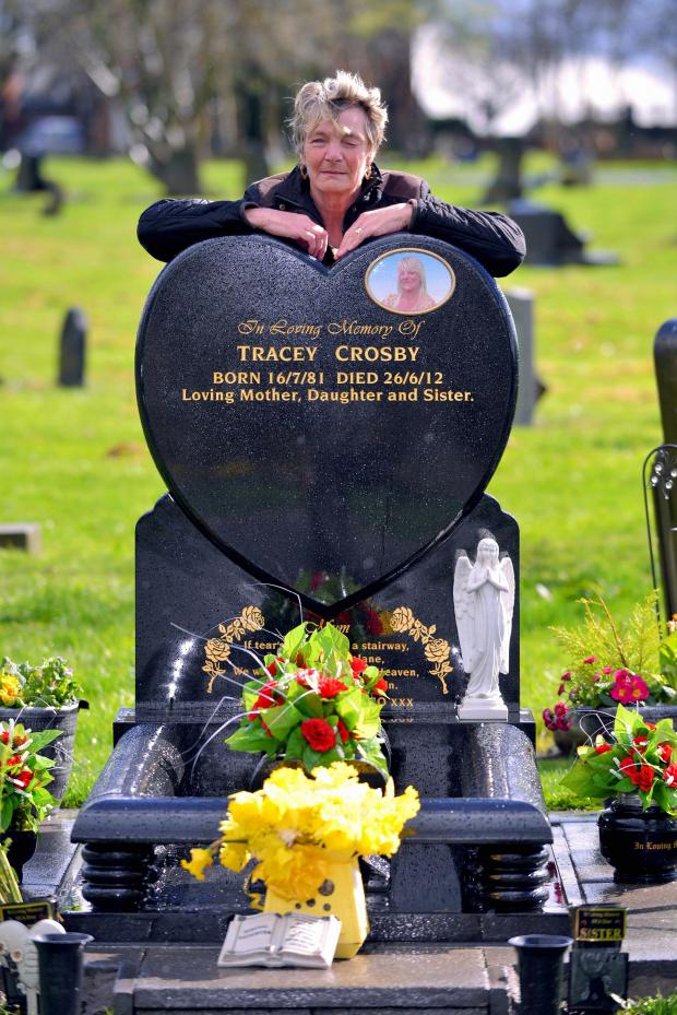 Bradford Telegraph and Argus: DAMAGE: Mary Crosby is pictured by her daughter Tracey Crosby's grave in Bowling Cemetery