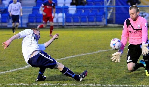 Alex Johnson gets a shot away in the handsome victory over AFC Telford. Now Guiseley must back that up
