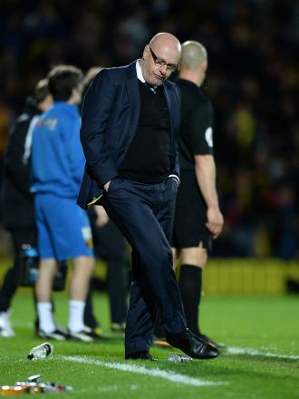 Leeds United manager Brian McDermott reacts after Watford score their third goal