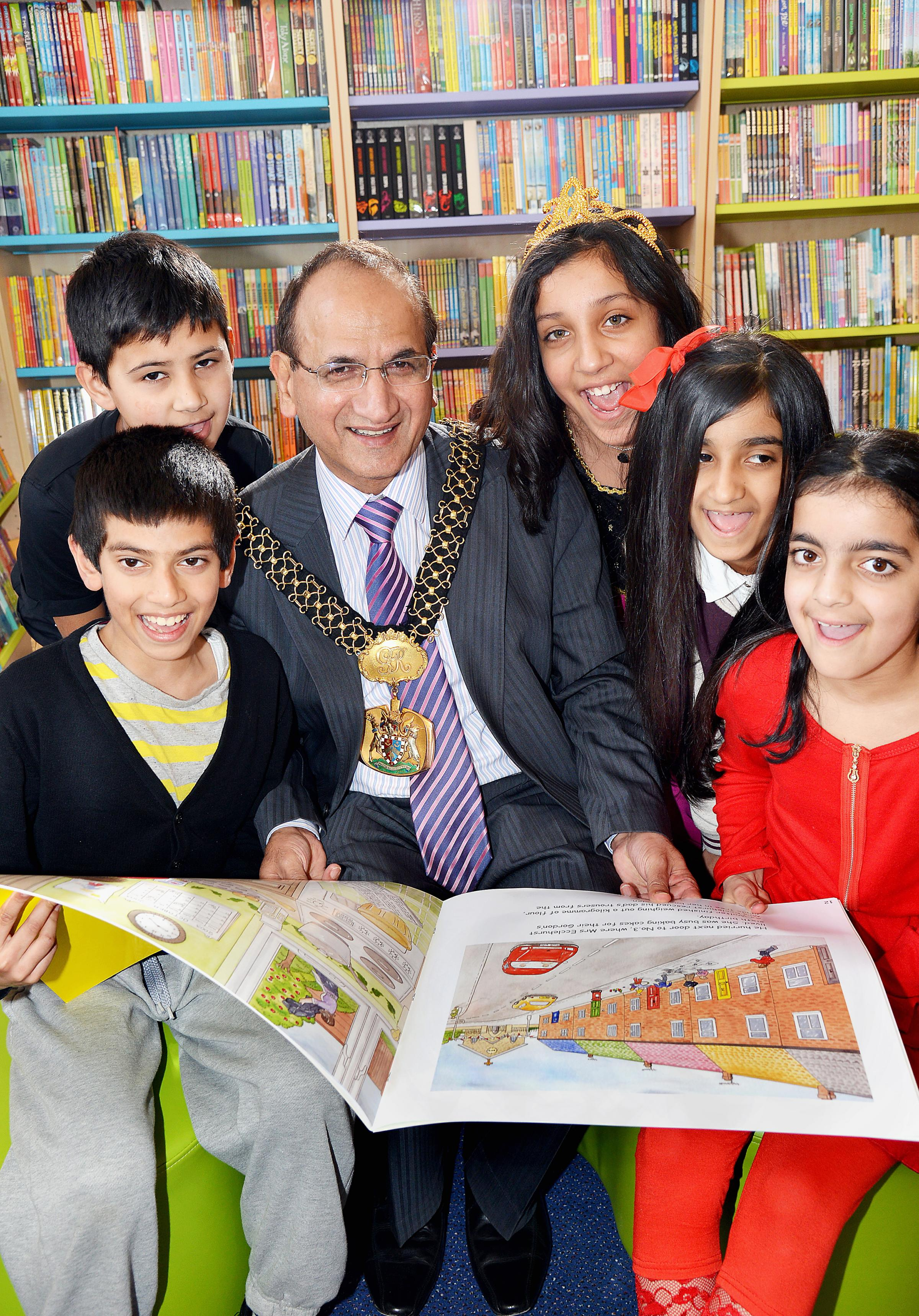 Lord Mayor of Bradford Councillor Khadim Hussain opens the library at Horton Grange Primary School Bradford with pupils (from left), Huzalfa Bismillah, nine, Subhan Ibrar, Amila Kauser, Muskaan Bhatti, and Maryam Alam (all ten)