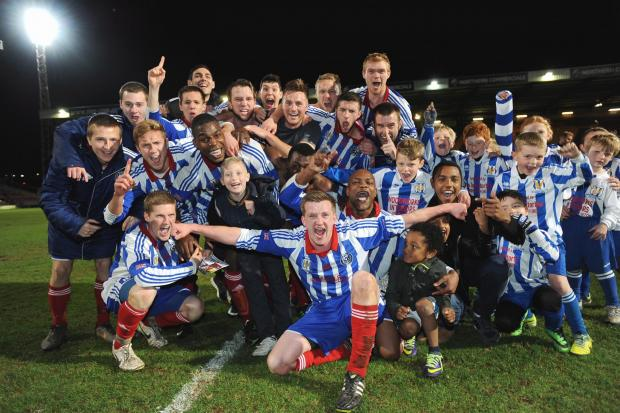 Eccleshill celebrate their County Cup triumph with Eagles youngsters