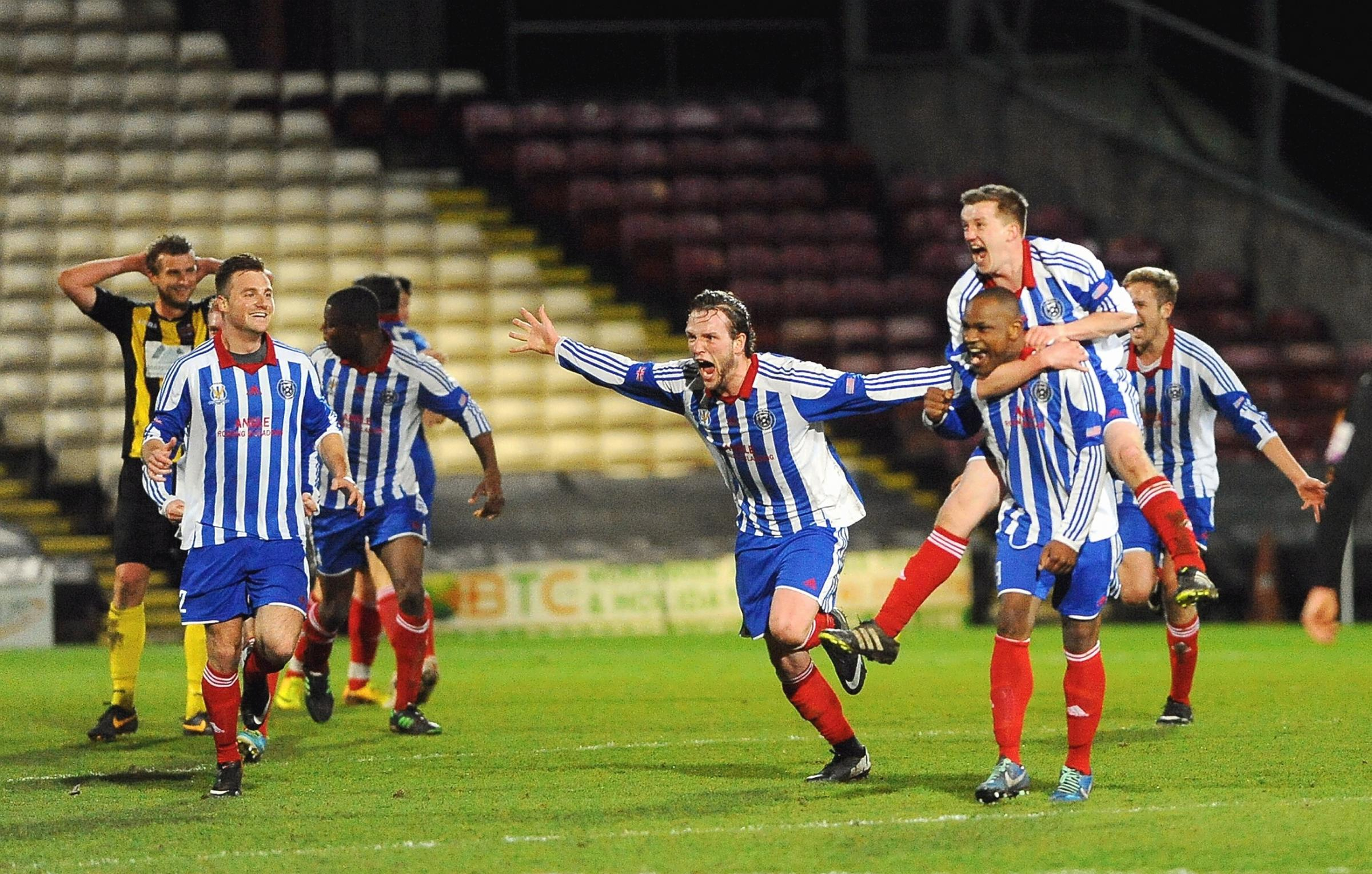 Eccleshill players celebrate their County Cup final win at Valley Parade