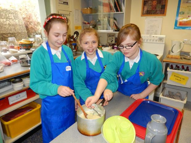 Some of the pupils busy preparing their dishes