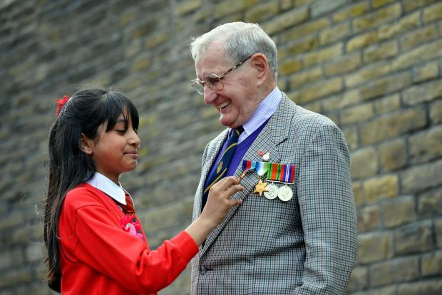 Year five pupil Ayshah Ahmed, who was celebrating her 10th birthday, with 89-year-old Edgar Bottomley