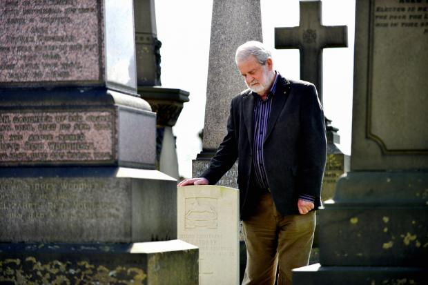 Bradford Telegraph and Argus: Allan Hillary of the Friends of Undercliffe Cemetery with some of the graves